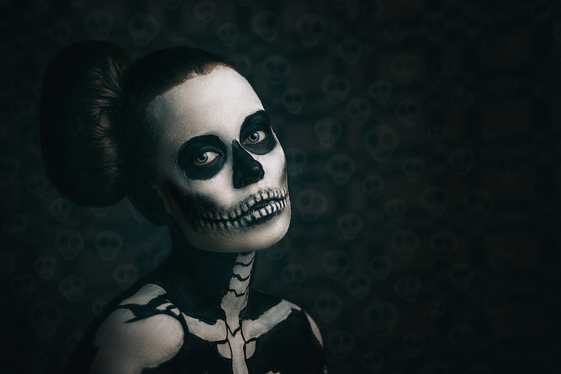 best skeleton make up in the studio on a black background. Halloween Costume. Close-up. Portrait