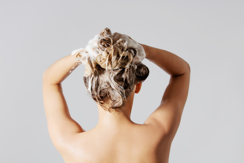 Woman washing her blond hair