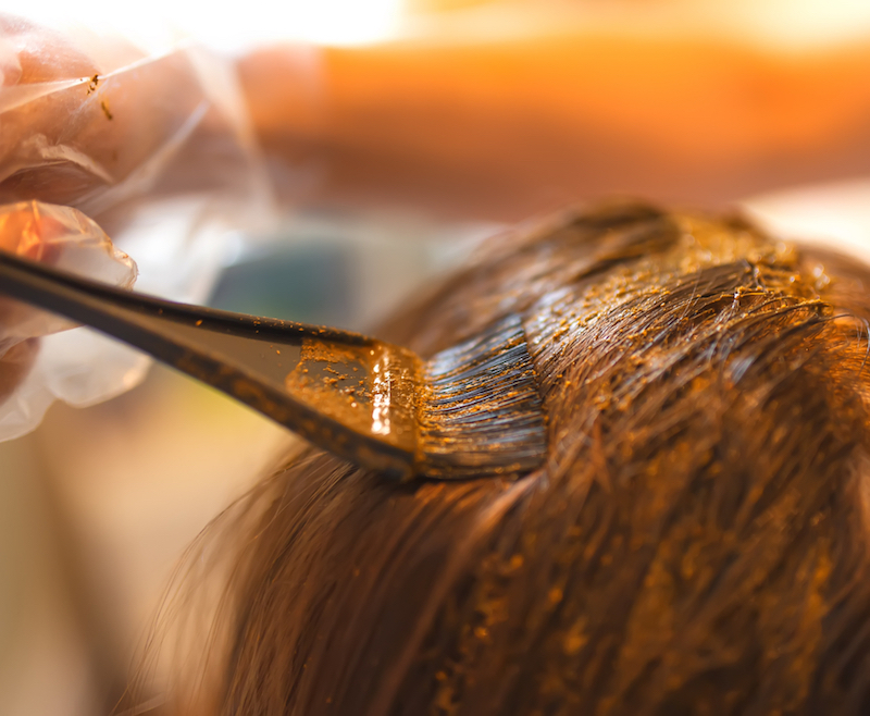 Process of coloring hair with natural henna.