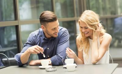 Beautiful couple having coffee on a date