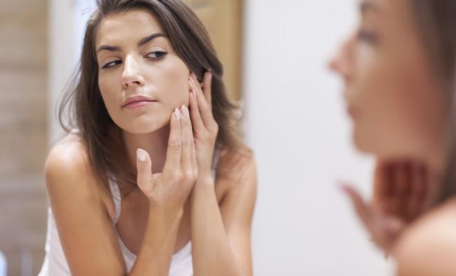 acne spot treatment, Woman taking care of her skin