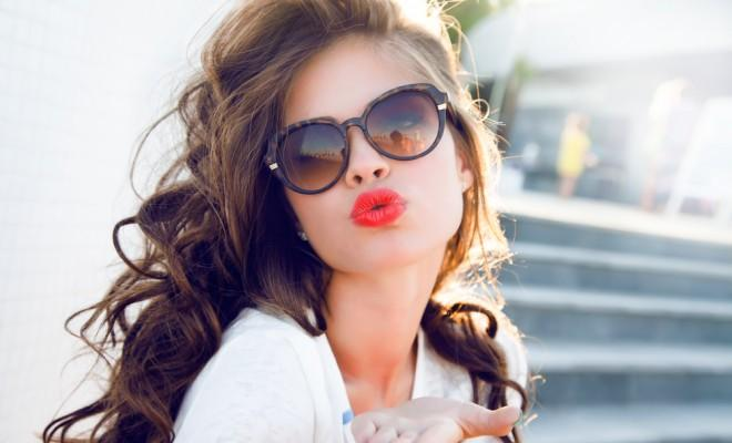 best lip plumpers, Young attractive woman face over isolated white background,send kiss,with red lips,amazing woman,hairstyle after salon,beauty face,party make-up,summer accessories,perfect bronze tan skin,lovely face