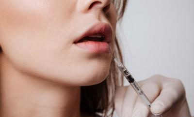Lip Fillers, Cropped image of young woman standing isolated over gray background and make lip injections. enhancementwomanaugmentationcloseupfullskinsurgerysyringeadultbackgroundbeautifulbeautybigcarecaucasiancliniccoldcollagencorrectioncosmeticcosmetologyfacefemalefillersgirlglamourheadhealthhealthyillinjectionisolatedliftinglipsmouthnaturalpeopleperfectpermanentplasticplumpproceduresalonsensualshapesicksicknesstreatmentwhiteyoungShow more