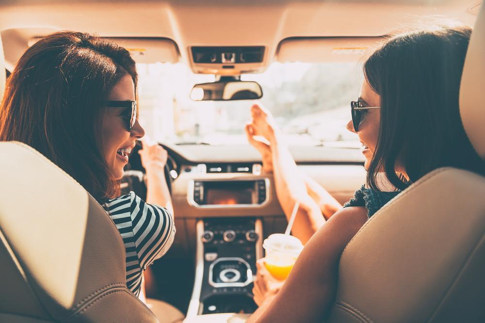 Perfect start of holidays. Rear view of two beautiful young cheerful women looking at each other with smile while sitting in car carwomenyoungdrivertripjourneysmilejuicerearviewleisurebeautifulseatfriendshipridingroadorangejoyfunfemalecheerfullookingactivityadultattractivebeautycandidcarefreecasualcaucasiancleavagedrinkdriversdrivingenjoymentexcitementexpressingeyewearhappinesshumaninsidelandlaughinglegmodeofpeoplepositivityrelaxationrentalsitting togetherness toothy transport travelling two vacations vehicle Show more
