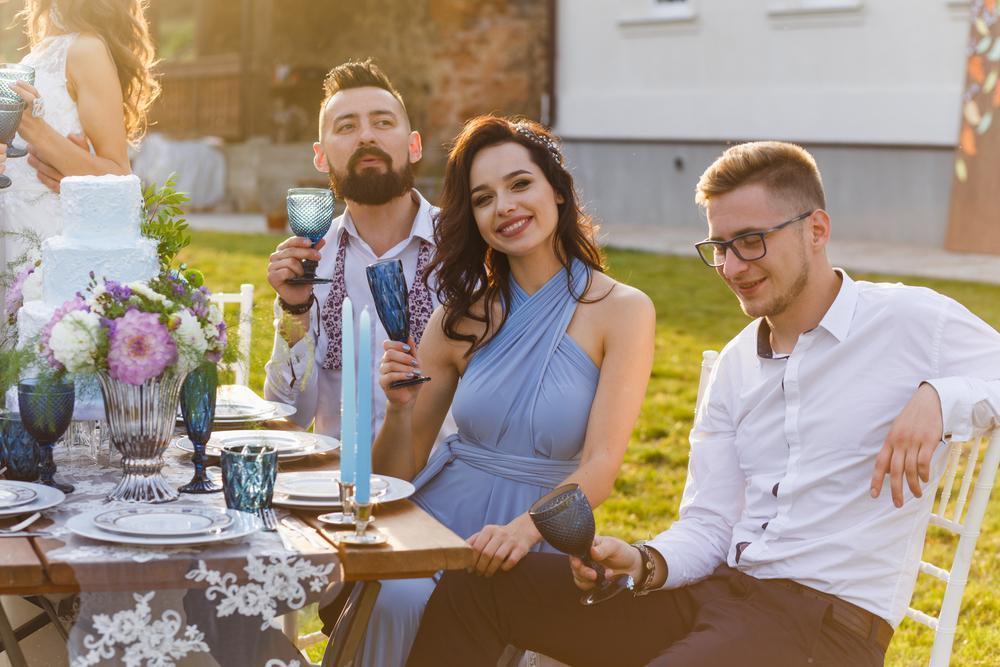 The newmarried couple and guests enjoy themselves at the Banquet table guestweddingfemalealcoholbeautifulbouquetbridebridesmaidcaucasiancelebrationchampagneclose-upcoupledaydressdrinkelegantengagementenjoymenteventfamilyflowerfriendfunglassgroomgroomsmengrouphappyindoorslifestyleloveluxurymarriagemarriedmenoutdoorpartypeoplepersonreceptionromancesittingsmilingspeechsuitsummertabletogethernesswomenShow more