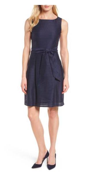woman in navy blue dress
