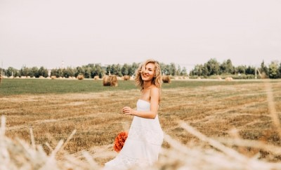 woman in white dress in field