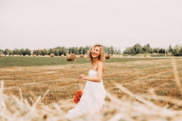 woman in white dress in field