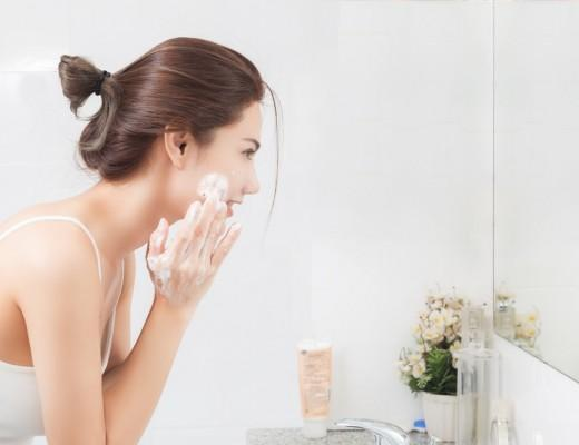 woman washing face